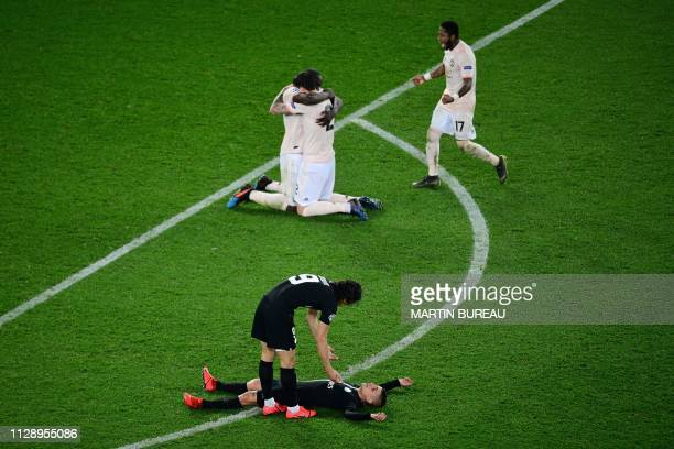 TOPSHOT Manchester United's players celebrate after winning the UEFA Champions League round of 16 secondleg football match between Paris SaintGermain...