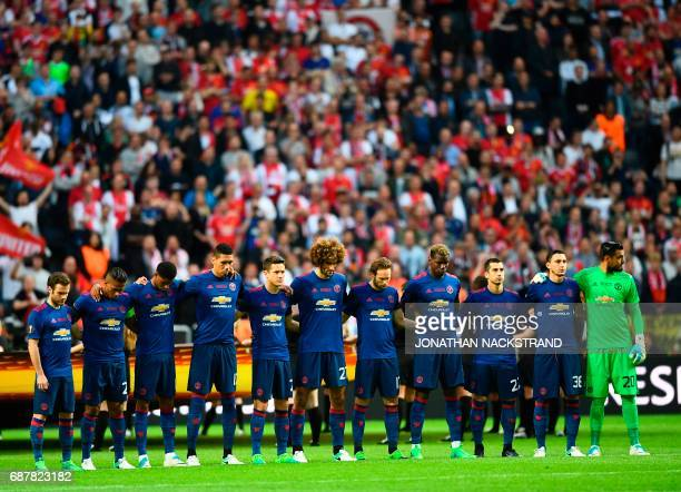 Manchester United's players observe a minute's silence for the victims of the bomb attack in Manchester ahead the UEFA Europa League final football...