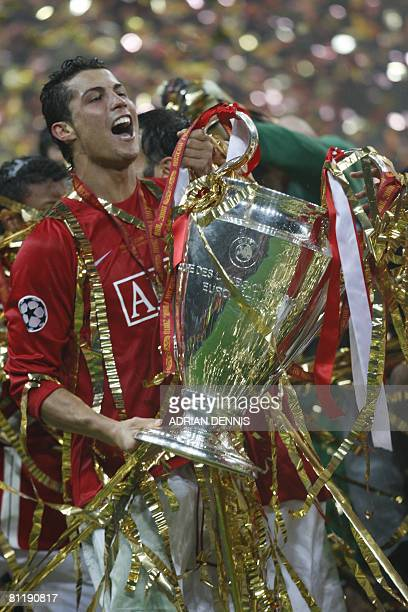 Manchester United's Portugese midfielder Cristiano Ronaldo celebrates with the trophy after beating Chelsea in the final of the UEFA Champions League...
