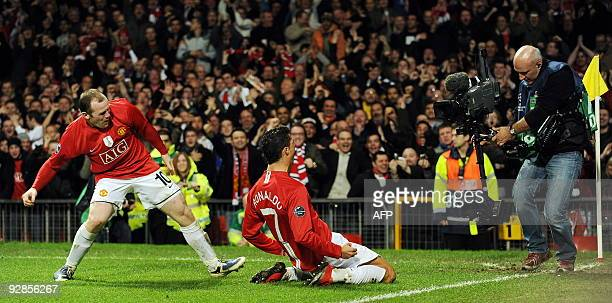 Manchester United's Portugese midfielder Cristiano Ronaldo celebrates with English forward Wayne Rooney after scoring against Inter Milan during...