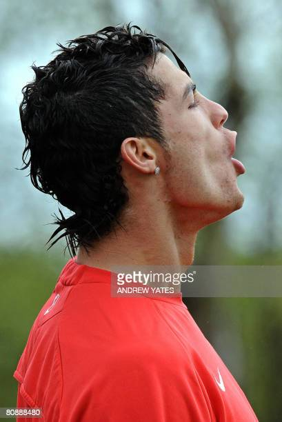 Manchester United's Portugese midfielder Cristiano Ronaldo in action during a team training session at the Carrington training complex in Manchester...