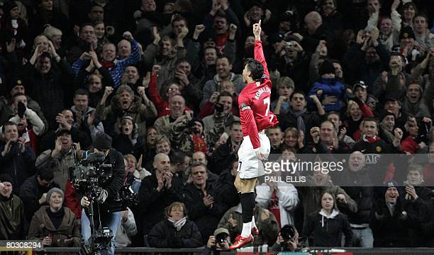 Manchester United's Portugese midfielder Cristiano Ronaldo of Portugal celebrates scoring against Bolton Wanderers during their English Premier...