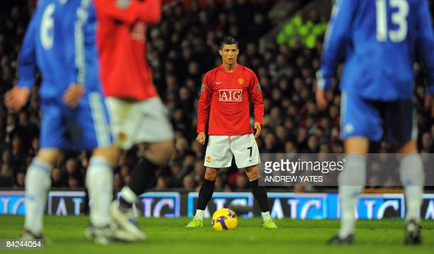 Manchester United's Portugese midfielder Cristiano Ronaldo prepares to take a free kick against Chelsea during their English Premier League football...