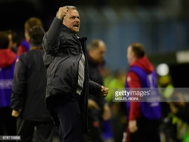 Manchester United's Portuguese coach Jose Mourinho celebrates their opener during their UEFA Europa League semi final first leg football match RC...