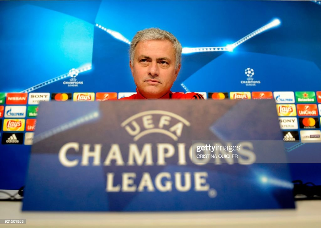 Manchester United's Portuguese coach Jose Mourinho (C) looks on as he attends a press conference at the Ramon Sanchez Pizjuan stadium in Sevilla on the eve of the UEFA Champions League football match between Sevilla and Manchester United on February 20, 2018. / AFP PHOTO / Cristina Quicler