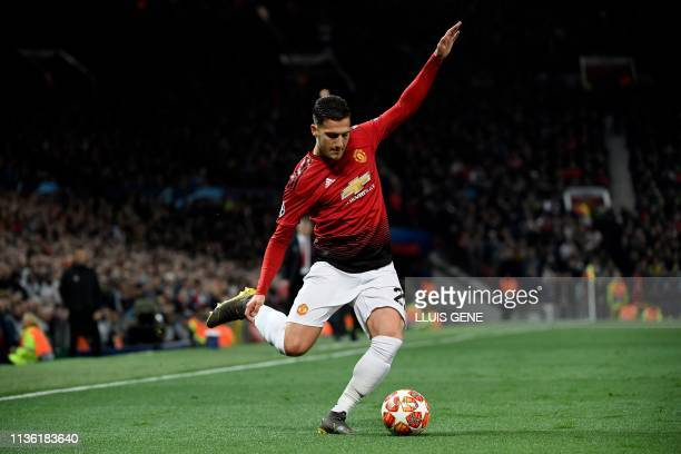 Manchester United's Portuguese defender Diogo Dalot crosses the ball during the UEFA Champions league first leg quarterfinal football match between...