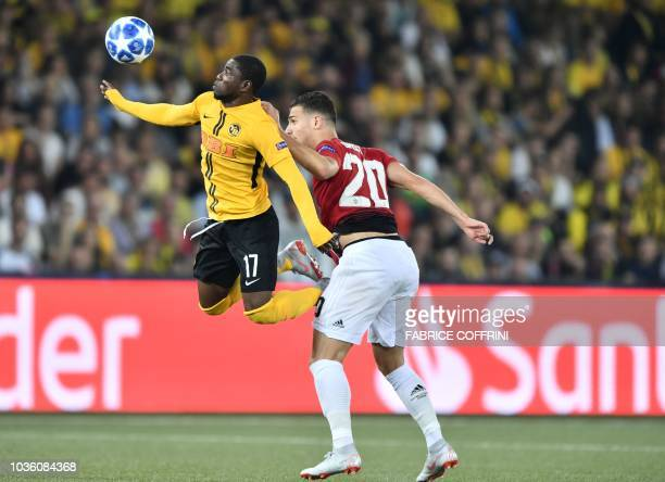 Manchester United's Portuguese defender Diogo Dalot fights for the ball with Young Boys Ivorian forward Roger Assalé during the UEFA Champions League...