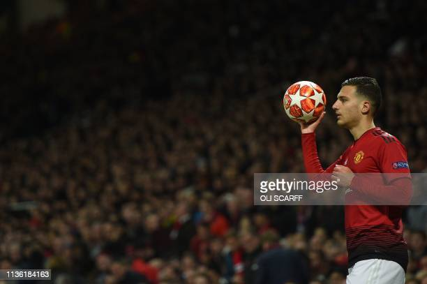 Manchester United's Portuguese defender Diogo Dalot readies for a throw in during the UEFA Champions league first leg quarterfinal football match...