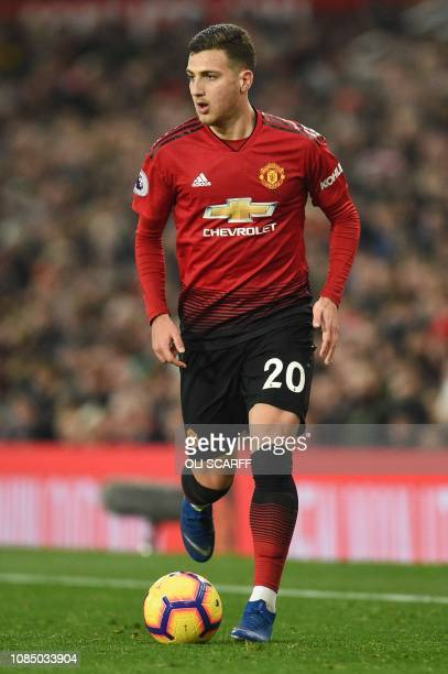 Manchester United's Portuguese defender Diogo Dalot runs with the ball during the English Premier League football match between Manchester United and...
