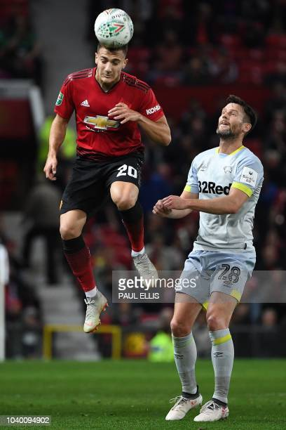 Manchester United's Portuguese defender Diogo Dalot vies with Derby's English striker David Nugent during the English League Cup third round football...