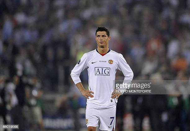 Manchester United's Portuguese forward Cristiano Ronaldo reacts at the end of the UEFA football Champions League Cup final against FC Barcelona on...