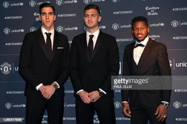 Manchester United's Portuguese goalkeeper Joel Castro Pereira Manchester United's Portuguese defender Diogo Dalot and Manchester United's Brazilian...