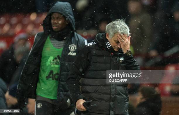 Manchester United's Portuguese manager Jose Mourinho and French midfielder Paul Pogba leave after the English FA Cup quarterfinal football match...