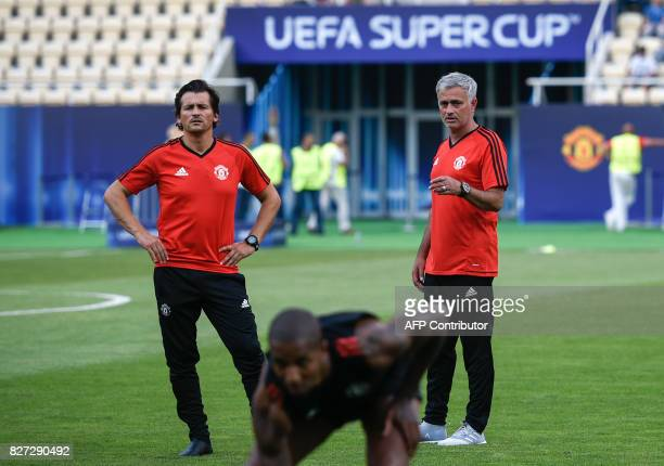 Manchester United's Portuguese manager Jose Mourinho and his assistant Rui Filipe da Cunha Faria look on during a training session ahead of the UEFA...