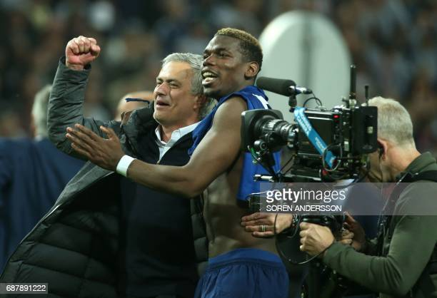 Manchester United's Portuguese manager Jose Mourinho and Manchester United's French midfielder Paul Pogba celebrate after their team won the UEFA...