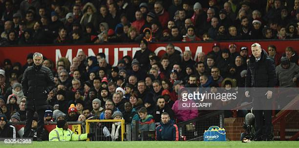 Manchester United's Portuguese manager Jose Mourinho and Sunderland's Scottish manager David Moyes stand on the touchline during the English Premier...