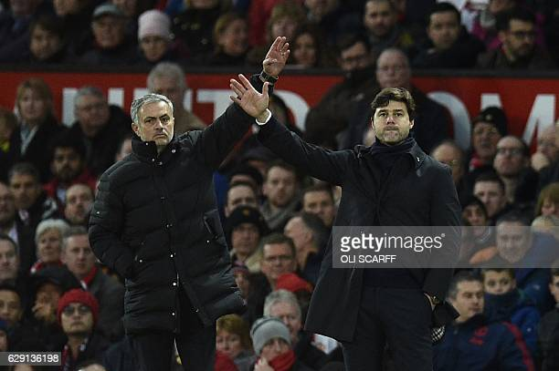 Manchester United's Portuguese manager Jose Mourinho and Tottenham Hotspur's Argentinian head coach Mauricio Pochettino gesture on the touchline...