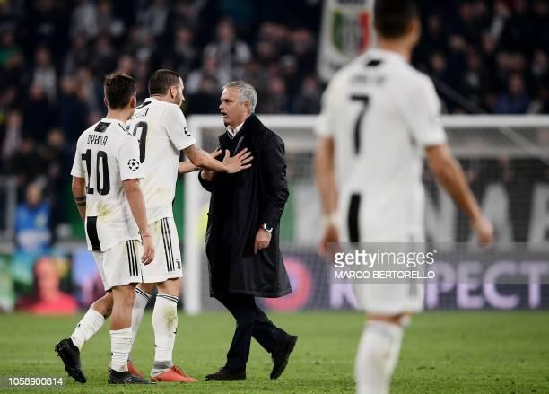 Manchester United's Portuguese manager Jose Mourinho argues with Juventus' Italian defender Leonardo Bonucci and Juventus' Argentine forward Paulo...