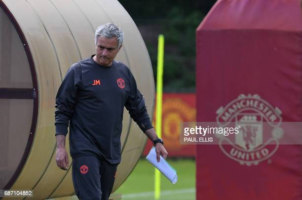 Manchester United's Portuguese manager Jose Mourinho arrives to attend a team training session at the club's training complex near Carrington west of...