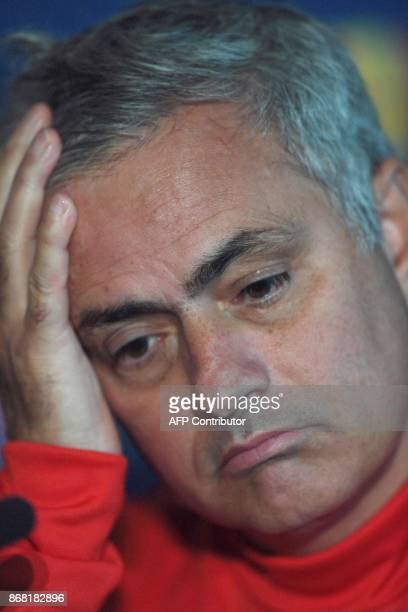 Manchester United's Portuguese manager Jose Mourinho attends a press conference at at Old Trafford in Manchester northwest England on October 30 on...