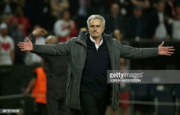 Manchester United's Portuguese manager Jose Mourinho celebrates after his team won the UEFA Europa League final football match Ajax Amsterdam v...