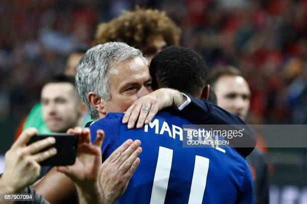 Manchester United's Portuguese manager Jose Mourinho celebrates French striker Anthony Martial after the UEFA Europa League final football match Ajax...