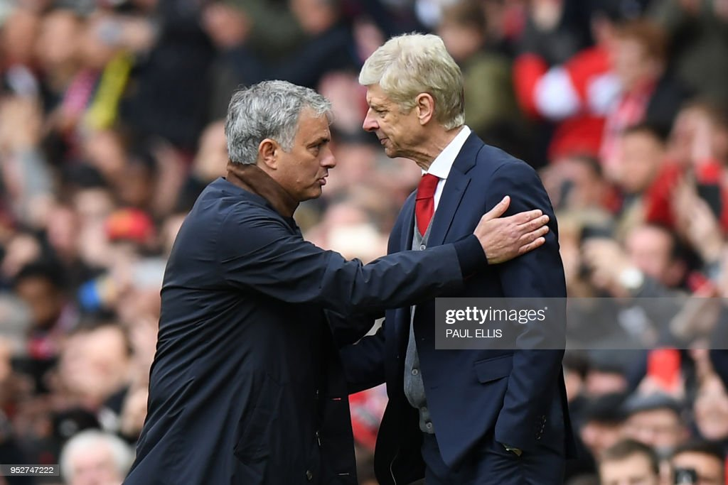 Manchester United's Portuguese manager Jose Mourinho (L) consoles Arsenal's French manager Arsene Wenger after the English Premier League football match between Manchester United and Arsenal at Old Trafford in Manchester, north west England, on April 29, 2018. - Manchester United won the game 2-1. (Photo by Paul ELLIS / AFP) / RESTRICTED TO EDITORIAL USE. No use with unauthorized audio, video, data, fixture lists, club/league logos or 'live' services. Online in-match use limited to 75 images, no video emulation. No use in betting, games or single club/league/player publications. /