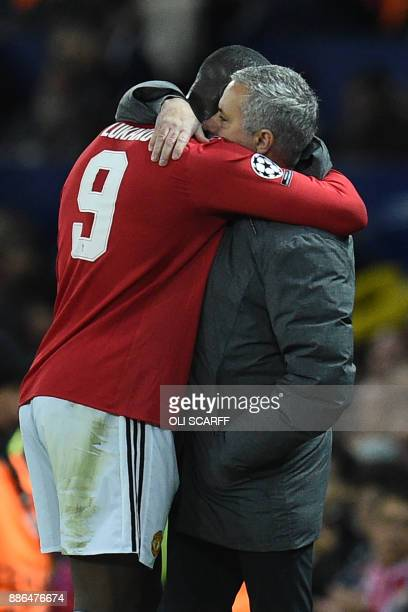 Manchester United's Portuguese manager Jose Mourinho embraces Manchester United's Belgian striker Romelu Lukaku as he is substituted during the UEFA...