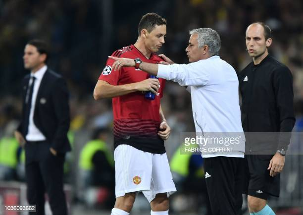 Manchester United's Portuguese manager Jose Mourinho gestures as he speaks with Manchester United's Serbian midfielder Nemanja Matic during the UEFA...