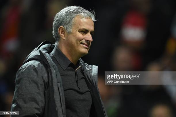 Manchester United's Portuguese manager Jose Mourinho gestures as he leaves after the UEFA Champions League Group A football match between Manchester...