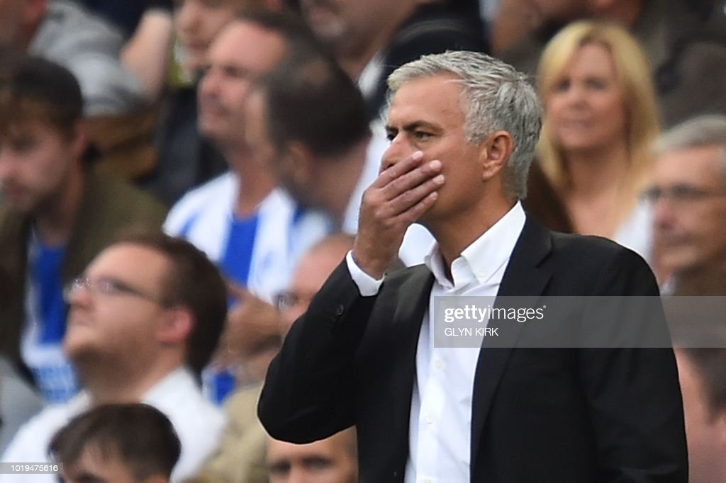 TOPSHOT - Manchester United's Portuguese manager Jose Mourinho gestures from the touchline during the English Premier League football match between Brighton and Hove Albion and Manchester United at the American Express Community Stadium in Brighton, southern England on August 19, 2018. (Photo by Glyn KIRK / AFP) / RESTRICTED TO EDITORIAL USE. No use with unauthorized audio, video, data, fixture lists, club/league logos or 'live' services. Online in-match use limited to 120 images. An additional 40 images may be used in extra time. No video emulation. Social media in-match use limited to 120 images. An additional 40 images may be used in extra time. No use in betting publications, games or single club/league/player publications. /