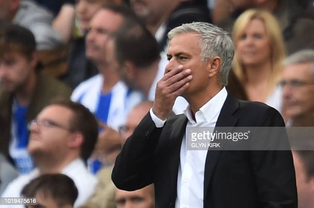 TOPSHOT Manchester United's Portuguese manager Jose Mourinho gestures from the touchline during the English Premier League football match between...