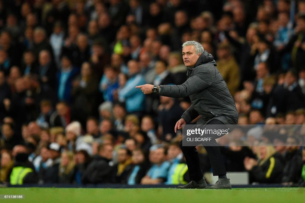 Manchester United's Portuguese manager Jose Mourinho gestures on the touchline during the English Premier League football match between Manchester City and Manchester United at the Etihad Stadium in Manchester, north west England, on April 27, 2017. / AFP PHOTO / Oli SCARFF / RESTRICTED TO EDITORIAL USE. No use with unauthorized audio, video, data, fixture lists, club/league logos or 'live' services. Online in-match use limited to 75 images, no video emulation. No use in betting, games or single club/league/player publications. /