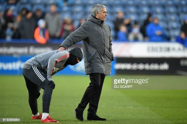 Manchester United's Portuguese manager Jose Mourinho gestures to Manchester United's French striker Anthony Martial during the warm up ahead of the...