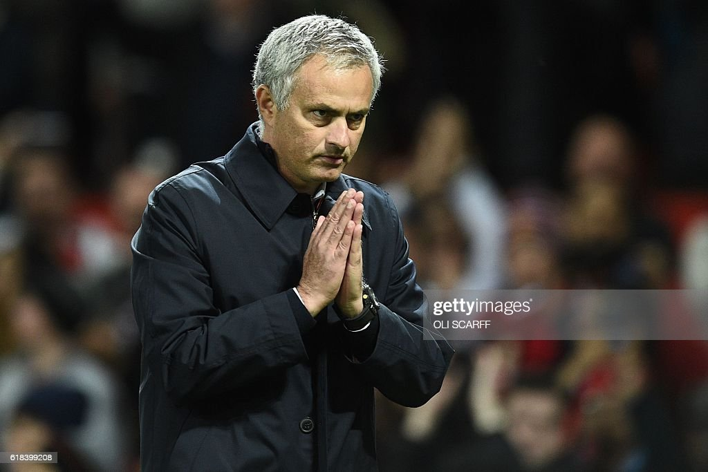 Manchester United's Portuguese manager Jose Mourinho gestures to supporters after the EFL (English Football League) Cup fourth round match between Manchester United and Manchester City at Old Trafford in Manchester, north west England on October 26, 2016. Manchester United won the game 1-0. / AFP / Oli SCARFF / RESTRICTED TO EDITORIAL USE. No use with unauthorized audio, video, data, fixture lists, club/league logos or 'live' services. Online in-match use limited to 75 images, no video emulation. No use in betting, games or single club/league/player publications. /