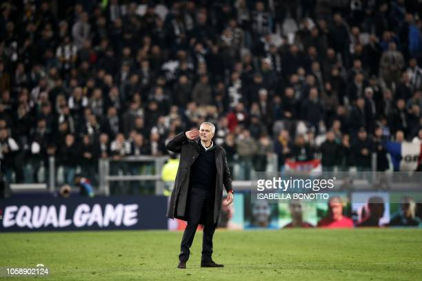 Manchester United's Portuguese manager Jose Mourinho gestures towards the public at the end of the UEFA Champions League group H football match...
