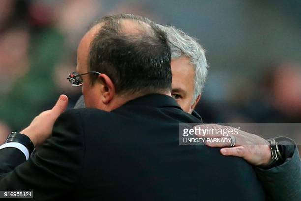 Manchester United's Portuguese manager Jose Mourinho hugs Newcastle United's Spanish manager Rafael Benitez at the end of the English Premier League...