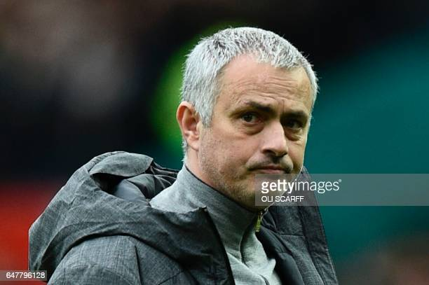 Manchester United's Portuguese manager Jose Mourinho is pictured on the pitch after the English Premier League football match between Manchester...