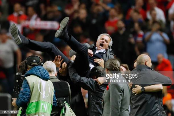 TOPSHOT Manchester United's Portuguese manager Jose Mourinho is thrown in the air by his staff after the UEFA Europa League final football match Ajax...