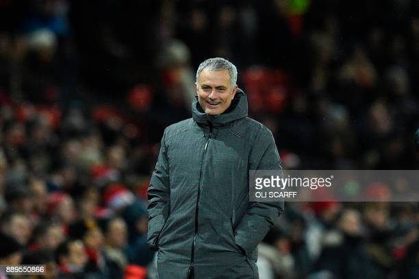 Manchester United's Portuguese manager Jose Mourinho laughs on the thouchline during the English Premier League football match between Manchester...