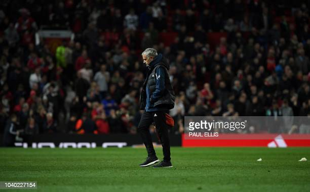 TOPSHOT Manchester United's Portuguese manager Jose Mourinho leaves teh pitch following the English League Cup third round football match between...