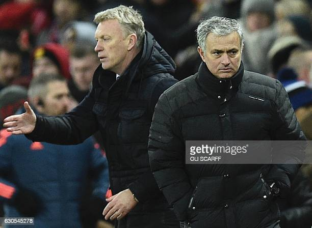 Manchester United's Portuguese manager Jose Mourinho leaves the field after shaking hands with Sunderland's Scottish manager David Moyes at the end...