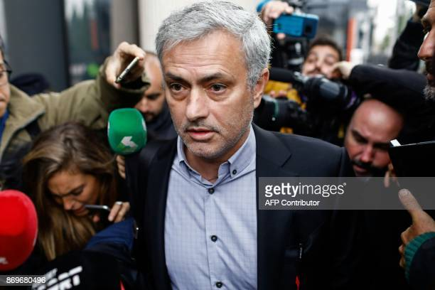 TOPSHOT Manchester United's Portuguese manager Jose Mourinho leaves the Courthouse in Pozuelo de Alarcon near Madrid on November 03 2017 Jose was...