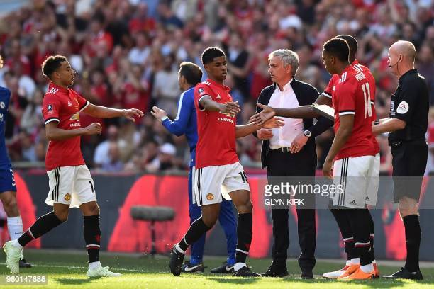 Manchester United's Portuguese manager Jose Mourinho looks on as he substitutes Manchester United's English striker Marcus Rashford and Manchester...