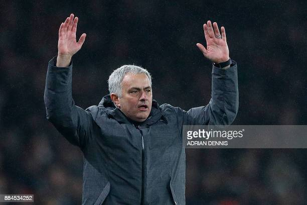 Manchester United's Portuguese manager Jose Mourinho reacts after Manchester United's Belgian striker Romelu Lukaku was fouled during the English...