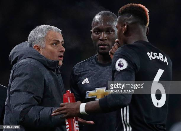 Manchester United's Portuguese manager Jose Mourinho reacts as he talks with Manchester United's Belgian striker Romelu Lukaku and Manchester...