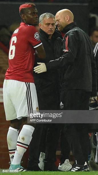 Manchester United's Portuguese manager Jose Mourinho reacts as Manchester United's French midfielder Paul Pogba leaves the pitch injured during the...
