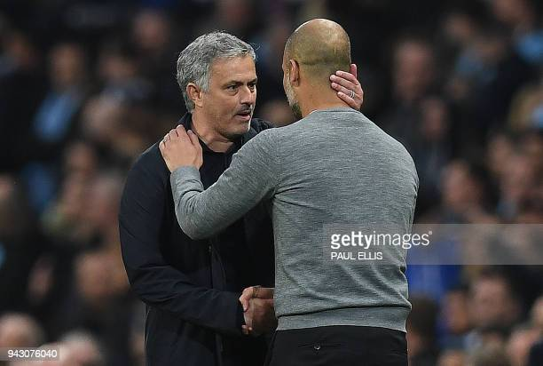 Manchester United's Portuguese manager Jose Mourinho shakes hands Manchester City's Spanish manager Pep Guardiola following the English Premier...
