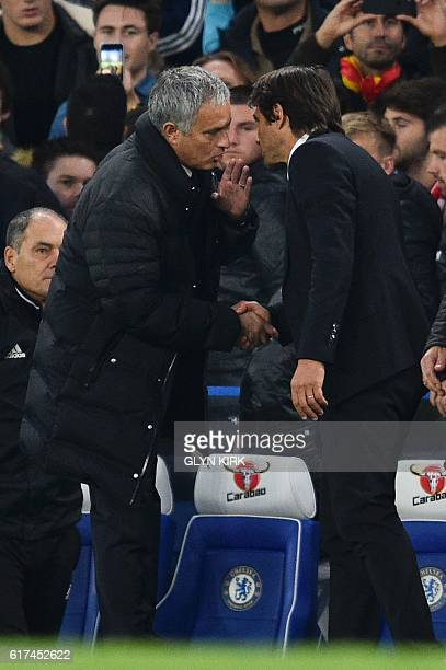 Manchester United's Portuguese manager Jose Mourinho shakes hands with Chelsea's Italian head coach Antonio Conte after the final whistle of the...