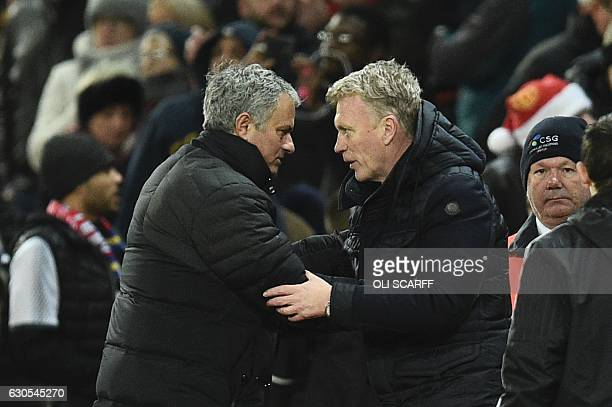 Manchester United's Portuguese manager Jose Mourinho shakes hands with Sunderland's Scottish manager David Moyes at the end of the English Premier...